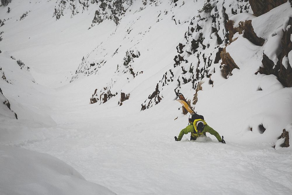 Rob Lea wallows through deep snow to reach the top of Tanner's Chute, a 3500 foot ski/snowboard couloir in the Wasatch Mountains, Utah