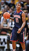 SHOT 1/21/12 5:36:21 PM - Arizona's Josiah Turner #11 dribbles the ball against Colorado during their PAC 12 regular season men's basketball game at the Coors Events Center in Boulder, Co. Colorado won the game 64-63..(Photo by Marc Piscotty / © 2012)