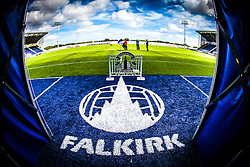 The new Falkirk sign on the blue part of the plastic pitch at the tunnell area, at Falkirk Stadium, with the new pitch, for the Scottish Championship game v Hamilton. The woven GreenFields MX synthetic turf and the surface has been specifically designed for football with 50mm tufts compared with the longer 65mm which has been used for mixed football and rugby uses.  It is fully FFA two star compliant and conforms to rules laid out by the SPL and SFL.<br /> ©Michael Schofield.