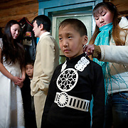 At the backstage of a school performance at the Bedime village in Yakutia..Village authorities is pushing villagers to join the United Russia party, which backs Russian President Vladimir Putin. .On one single day this year, 136 people in his village joined the party. .United Russia is a political party in the Russian Federation which usually labels itself centrist. It can be seen as Putin's vehicle in the State Duma (the lower house of Russian parliament). It was founded in April 2001 as a merger between Yuriy Luzhkov's, Yevgeny Primakov's and Mintimer Shaeymiev's Fatherland - All Russia party, and the Unity Party of Russia, led by Sergei Shoigu and Alexander Karelin..United Russia is a relatively new party in the Russian Parliament but has been making great gains in recent federal and local elections due to the popularity of Putin.