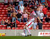Photo. Glyn Thomas.Digitalsport<br /> Stoke City v Wolverhampton Wanderers. <br /> Coca Cola Championship. 08/08/2004.<br /> Stoke's Clive Clarke score from the penalty spot to put his side two goals in front.