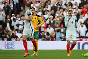 Jamie Vardy of England making hand gesture to John Stones of England after scoring 2-0 during the FIFA World Cup Qualifier group stage match between England and Lithuania at Wembley Stadium, London, England on 26 March 2017. Photo by Matthew Redman.