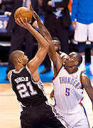 June 2, 2012; Oklahoma City, OK, USA; Oklahoma City Thunder center Kendrick Perkins (5) attempts to block a shot taken by San Antonio Spurs forward Tim Duncan (21) during the second half of a playoff game at Chesapeake Energy Arena.  Thunder defeated the Spurs 109-103 Mandatory Credit: Beth Hall-US PRESSWIRE
