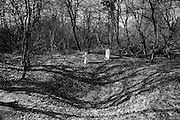 Verdun WW1 Battlefield site, Verdun-sur-Meuse,Steles des Basques, France. March 2014<br /> Shell cratered location of Basques fighters from the Basque region of Northern Spain who faught and died fighting for France against the Germans, near Fort de Vaux on the Verdun Battlefield.<br /> The Battle of Verdun lasted 9 months, 3 weeks and 6 days between 21 February and 20 december 1916. It was the longest and one of the most costly battles in human history;  recent estimates increase the number of casualties to 976,000.<br /> <br /> Caption information below from wikipedia:<br /> The Battle of Verdun (Bataille de Verdun0, was fought from 21 February – 18 December 1916 during the First World War on the Western Front between the German and French armies, on hills north of Verdun-sur-Meuse in north-eastern France. The German Fifth Army attacked the defences of the Région Fortifiée de Verdun (RFV) and the Second Army on the right bank of the Meuse, intending rapidly to capture the Côtes de Meuse (Meuse Heights) from which Verdun could be overlooked and bombarded with observed artillery-fire. The German strategy intended to provoke the French into counter-attacks and counter-offensives to drive the Germans off the heights, which would be relatively easy to repel with massed artillery-fire from the large number of medium, heavy and super-heavy guns, supplied with large amounts of ammunition on excellent pre-war railways, which ran within 24 kilometres (15 mi) of the front-line.<br /> <br /> The German strategy assumed that the French would attempt to hold onto the east bank of the Meuse, then commit the French strategic reserve to recapture it and suffer catastrophic losses from German artillery-fire, while the German infantry held positions easy to defend and suffered few losses. The German plan was based on the experience of the September – October 1915 battles in Champagne (Herbstschlacht) when after early success the French offensive was defeated with far more French tha