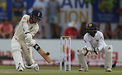 November 6, 2018 - Galle, Sri Lanka - England cricketer Sam Curran (L) plays a shot as Sri Lankan wicket keeper Niroshan Dickwella looks on during the  1st day's play  of the first test cricket match between Sri Lanka and England at Galle International cricket stadium, Galle, Sri Lanka on November 6, 2018. (Credit Image: © Tharaka Basnayaka/NurPhoto via ZUMA Press)
