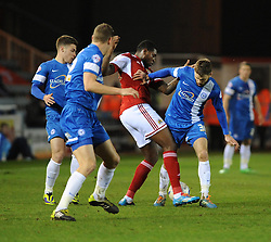 Bristol City's Jay Emmanuel-Thomas is challenged by Peterborough United's Charlie Horton - Photo mandatory by-line: Dougie Allward/JMP - Mobile: 07966 386802 11/03/2014 - SPORT - FOOTBALL - Peterborough - London Road Stadium - Peterborough United v Bristol City - Sky Bet League One