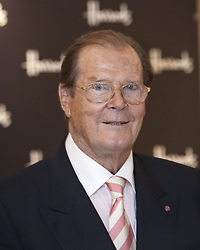 Oct. 11, 2012 - London, London, UK - London, U.K..Actor Roger Moore signing his new book 'Bond On Bond' At Harrods Store in knightsbridge, London, today (11/10/2012). The James Bond legend appears in store to sign copies of his new book, Bond on Bond (published October 4)..Photo credit : Rich Bowen/LNP (Credit Image: © Rich Bowen/London News Pictures/ZUMAPRESS.com)