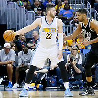 08 April 2016: San Antonio Spurs center Tim Duncan (21) defends on Denver Nuggets center Jusuf Nurkic (23) during the Denver Nuggets 102-98 victory over the San Antonio Spurs, at the Pepsi Center, Denver, Colorado, USA.