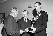 24/07/1967<br /> 07/24/1967<br /> 24 July 1967<br /> Handing over Irish Mist Trophy to Federation of Irish Beekeepers at Gormanstown College, Co. Meath. At the official opening of the 1967 Summer Course of the Federation of Irish Beekeepers at Gormanstown College Co. Dublin, a new Perpetual Challenge Trophy was handed over to the Federation by the Irish Mist Liqueur Co., Tullamore, to be awarded each year for the supreme run honey entered at the Irish National Honey Show. That years show was held on the 27 July. Photo shows Mr. W.G. Jaffray (centre), Director Irish Mist Liqueur Co., handing over the Irish Mist Trophy to Mr. J.J. Doran (right), Kilkenny, President of the Federation and Mr. J.A. Ahern, (Cork) Secretary of the Federation.