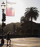 """22 February 2010-Santa Barbara, CA: Pedestrian walks up State Street and pass the Santa Barbara Train Station.  """"The State Street Walk"""" Photo By Rod Rolle.It was a nice afternoon for a State Street walk."""