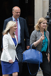 Downing Street, London, June 2nd 2015. Amber Rudd, Secretary of State for Energy and Climate Change, right, followed by Elizabeth Truss, Secretary of State for Environment, Food and Rural Affairs and Leader of the House Chris Grayling, leaves 10 Downing Street following the weekly meeting of the Cabinet.