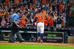 April 13, 2018 - Houston, TX, U.S. - HOUSTON, TX - APRIL 13: Houston Astros center fielder George Springer (4) reacts after hitting a lead-off home-run  in the first inning during an MLB game between the Houston Astros and the Texas Rangers and April 13, 2018 at Minute Maid Park in Houston, TX.  (Photo by Juan DeLeon/Icon Sportswire) (Credit Image: © Juan Deleon/Icon SMI via ZUMA Press)