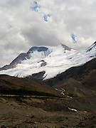 View of the snowfield just to the south of Athabasca Glacer along the Icefields Parkway, Jasper National Park, Alberta, Canada, on an overcast day.