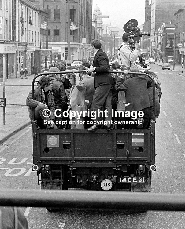 Army lorry full of journalists being taken to a photo facility during the curfew.  The photograph was taken from a second lorry conveying journalists. 197007030251f..The British Army imposed during July 3 & 4, 1970, a 34 hour curfew (except for a two hour break to allow shopping) in approximately 50 streets in the Lower Falls district of Belfast, N Ireland, UK. A military helicopter hovered overhead warning people they would be arrested if they remained on the streets. An army search during the curfew uncovered 100 firearms, 100 home-made bombs, 250 lbs of explosives, 21000 rounds of ammunition and 8 two-way radios. This curfew is often seen as a turning point in souring relations between the Roman Catholic working class and the British Army. The army was no longer seen as the protector of the Catholic community.<br /> <br /> Copyright Image from Victor Patterson, Belfast, UK<br /> <br /> t: +44 28 9066 1296 (from Rep of Ireland 048 9066 1296)<br /> m: +44 7802 353836<br /> e: victorpattersonbelfast@gmail.com<br /> <br /> www.images4media.com<br /> <br /> Please see my full Terms and Conditions of Use at https://www.images4media.com/p/terms-conditions - it is IMPORTANT that you familiarise yourself with them.<br /> <br /> Images used online incur an additional cost. This cost should be agreed in writing in advance. Online images must be visibly watermarked i.e. © Victor Patterson or that of the named photographer within the body of the image. The original metadata must not be deleted from images used online.<br /> <br /> This image is only available for the use of the download recipient i.e. television station, newspaper, magazine, book publisher, etc, and must not be passed on to a third party. It is also downloaded on condition that each and every usage is notified within 7 days to victorpattersonbelfast@gmail.com.