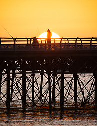 © Licensed to London News Pictures. 30/10/2017. Southsea, UK.  Two anglers fishing during a chilly sunrise on Southsea pier this morning, 30th October 2017. Photo credit: Rob Arnold/LNP