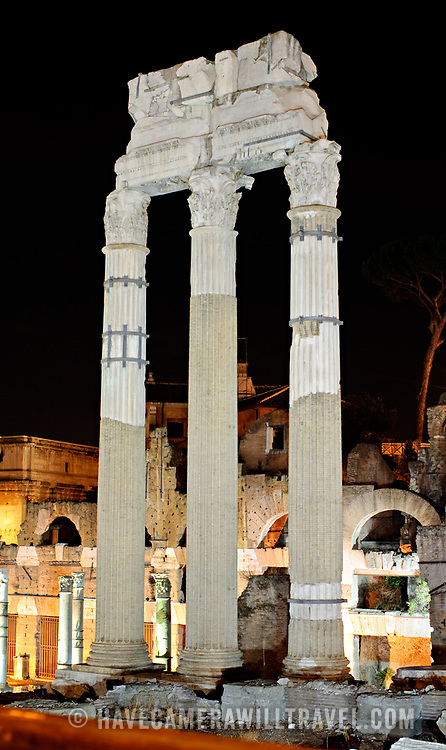 ROME, Italy - Tall columns of the Roman ruins of the Foro Romano in Rome, Italy, at night.