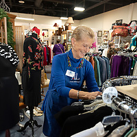 11/20/19 -<br /> <br /> Volunteer Norma King, Vice President of resource development, straightens up merchandise on the sales floor at the Assistance League of Greater Wilmington Thrift Shop.<br /> <br /> <br /> Photo by Michael Cline Spencer