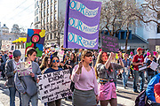 """San Francisco, USA. 19th January, 2019. A group of young adults carry signs including """"Our bodies. Our minds. Our power,"""" """"I'm with her,"""" and more in the Women's March San Francisco begins with a rally at Civic Center Plaza in front of City Hall. Credit: Shelly Rivoli/Alamy Live News"""