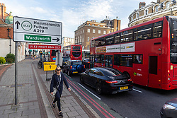 Licensed to London News Pictures. 25/10/2021. London, UK. Heavy traffic as cars queue up at traffic lights crossing the South Circular at Putney south-west London today as the ULEZ extended boundary comes in to force. Today the London Ultra-Low Emission Zone (ULEZ) area has been expanded to inside the North and South Circular with many drivers of older vehicles forced to pay a daily £12.50 fee or face heavy fines of £160.00. Photo credit: Alex Lentati/LNP