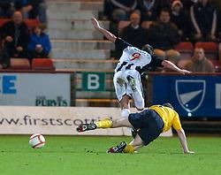 Dunfermline's Andy Barrowman tackled by Falkirk's Darren Dods..Dunfermline 0 v 1 Falkirk, 26/12/2012..©Michael Schofield.