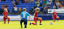 BIRKENHEAD, ENGLAND - Sunday, August 29, 2021: Liverpool's Leanne Kiernan kneels down (takes a knee) in support of the Black Lives Matter movement before the FA Women's Championship game between Liverpool FC Women and London City Lionesses FC at Prenton Park. London City won 1-0. (Pic by Paul Currie/Propaganda)