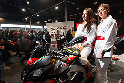 Models on a new bike in the Aprilia booth at Motor Bike Expo (MBE) bike show. Verona, Italy. Sunday, January 19, 2020. Photography ©2020 Michael Lichter.