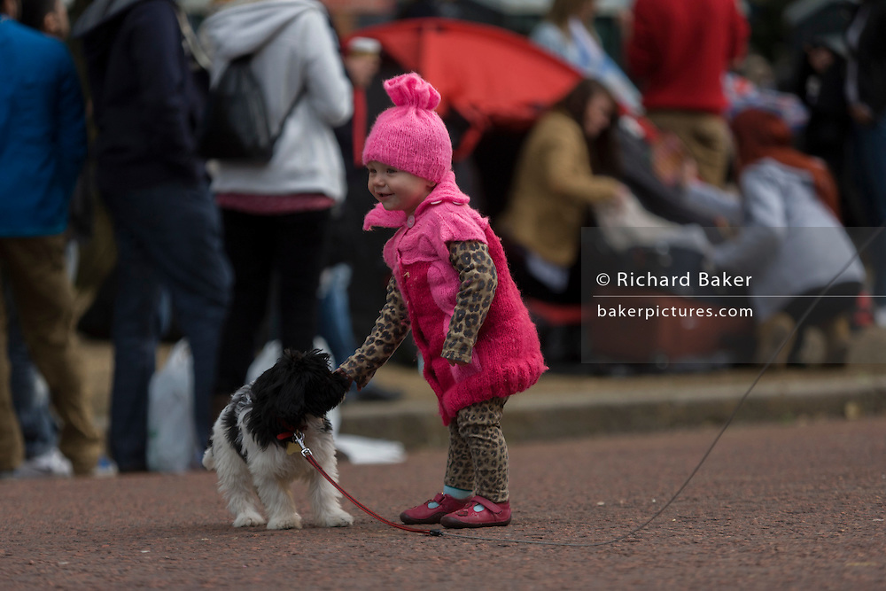 Child and dog celebrate their Queen's Diamond Jubilee weeks before the Olympics come to London. The UK enjoys a weekend and summer of patriotic fervour as their monarch celebrates 60 years on the throne. Across Britain, flags and Union Jack bunting adorn towns and villages.