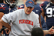Virginia head coach Al Groh talks with the defense during an ACC football game Saturday in Charlottesville, VA. Duke won 28-17. Photo/Andrew Shurtleff