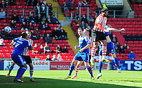 Lincoln City's Hamza Bencherif scores the opening goal <br /> <br /> Photo by Chris Vaughan/CameraSport<br /> <br /> Football - English Football Vanarama Conference Premier League - Lincoln City v FC Halifax Town - Monday 6th April 2015 - Sincil Bank - Lincoln<br /> <br /> © CameraSport - 43 Linden Ave. Countesthorpe. Leicester. England. LE8 5PG - Tel: +44 (0) 116 277 4147 - admin@camerasport.com - www.camerasport.com