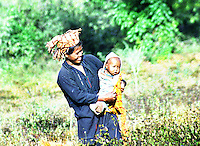 BURMA (MYANMAR) Shan State,Kalaw, 2006. A proud Pa-O mother shows off her child during a break in the January Sesame harvest. The hill country around Kalaw includes many Pa-O, Palaung and Danu tribespeople.
