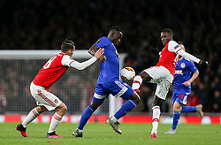 Mady Camara of Olympiacos under pressure from - Mandatory by-line: Arron Gent/JMP - 27/02/2020 - FOOTBALL - Emirates Stadium - London, England - Arsenal v Olympiacos - UEFA Europa League Round of 32 second leg