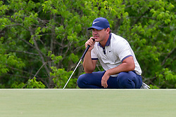 May 9, 2019 - Dallas, TX, U.S. - DALLAS, TX - MAY 09: Brooks Koepka lines up his putt on the seventh green during the first round of the AT&T Byron Nelson on May 9, 2019 at Trinity Forest Golf Club in Dallas, TX. (Photo by Andrew Dieb/Icon Sportswire) (Credit Image: © Andrew Dieb/Icon SMI via ZUMA Press)