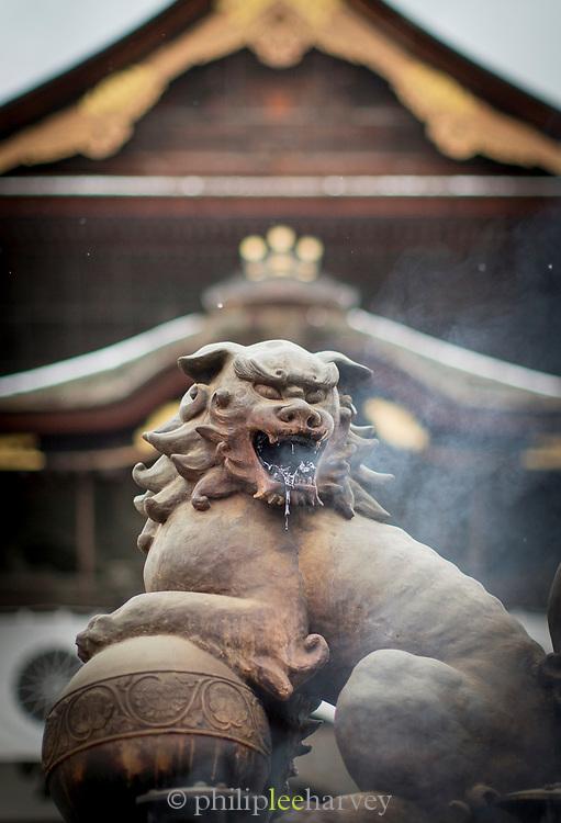 Dragon statue breathing incense smoke at Zenko-ji Temple in Nagano, Japan