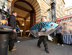 © Licensed to London News Pictures. 12/05/2012. Bristol, UK. Picture of Zoe Strickland in fish costume at the Corn Exchange in Corn Street, Bristol, part of the Greenpeace south west launch of Be A Fisherman's Friend campaign on supporting sustainable fishermen, getting the public's support.  12 May 2012..Photo credit : Simon Chapman/LNP