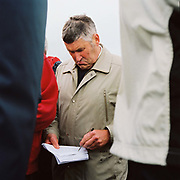 Male spectator by the betting kiosks at the Tiverton Staghounds point-to-point steeplechases at Bratton Down, Barnstaple, Devon, UK. Fundraiser for the Devon and Somerset Staghounds.