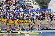 Sydney, AUSTRALIA, GBR M8+Bow Andrew LINDSAY, throws his arms back as the GB crew cross the finishing line to win the Olympic Gold Medal by 0.8/sec, at the 2000 Olympic Regatta, Penrith Lakes. [Photo Peter Spurrier/Intersport Images]  [left to right] LINDSAY, Andrew, HUNT-DAVIS, Ben, DENNIS, Simon, ATTRILL, Louis, GRUBOR, Luka, WEST, Kieran<br /> SCARLETT, Fred, TRAPMORE Steve and cox DOUGLAS, Rowley 2000 Olympic Rowing Regatta00085138.tif