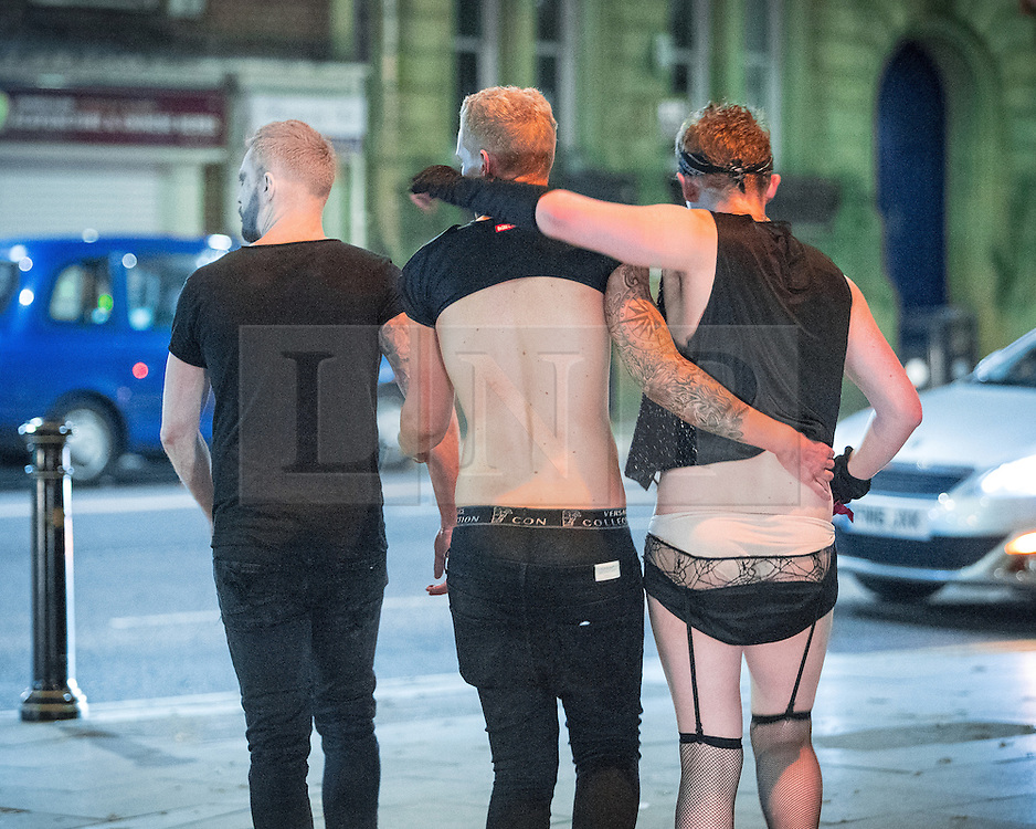 © Licensed to London News Pictures . 30/10/2016 . Manchester , UK . Revellers on a night out , many in fancy dress , on the weekend before Halloween . Photo credit : Joel Goodman/LNP
