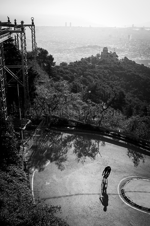 Cyclist turns a corner on steep climb to Tididabo, Barcelona. Prints on Hahnemühle fine art photo paper available - contact me!