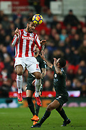 Eric Maxim Choupo-Moting of Stoke City heads the ball. Premier league match, Stoke City v Manchester City at the Bet365 Stadium in Stoke on Trent, Staffs on Monday12th March 2018.<br /> pic by Andrew Orchard, Andrew Orchard sports photography.
