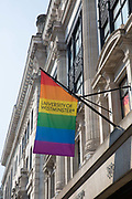 University of Westminster hangs the Pride rainbow flag on Regents Street during the Pride London celebrations on the 7th July 2018 in central London in the United Kingdom. 30,000 marched through central London for the city's annual LGBT Pride celebration.