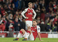 Football - 2017 / 2018 UEFA Europa League - Semi-Final, First Leg: Arsenal vs. Atletico Madrid<br /> <br /> Shkodran Mustafi (Arsenal FC) sits on the grass at the end of the game after his error gifted Atletico Madrid an away goal at The Emirates.<br /> <br /> COLORSPORT/DANIEL BEARHAM