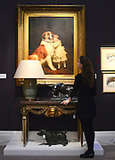 """© Licensed to London News Pictures. 18/03/2013. London, UK A girl looks at """"Good Friends 1889"""" by Charles Burnton Barber with an estimated value of 80,000-120,000GBP. Press call for The Collection of Mark Birley at Sotheby's auction house today 18th March 2013. Mark Birley was the owners of members only clubs Annabel's, Mark's Club, George's Bar, Harry's Bar and The Bath and Racquets Club in London. Photo credit : Stephen Simpson/LNP"""
