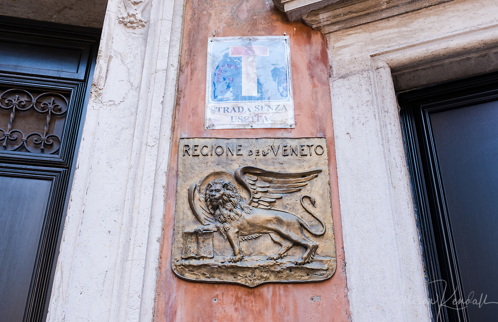 Detail of a decorative plaque, featuring the winged lion symbol of Venice, Italy
