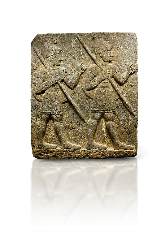 Picture & image of Hittite monumental relief sculpted orthostat stone panel from the Herald's Wall. Basalt, Karkamıs, (Kargamıs), Carchemish (Karkemish), 900-700 B.C. Military parade with soldiers. Anatolian Civilisations Museum, Ankara, Turkey<br /> <br /> Two helmeted soldiers marching soldiers in short skirts carry the shield on their backs and the spears in their hands.  <br /> <br /> Against a white background. .<br />  <br /> If you prefer to buy from our ALAMY STOCK LIBRARY page at https://www.alamy.com/portfolio/paul-williams-funkystock/hittite-art-antiquities.html  - Type  Karkamıs in LOWER SEARCH WITHIN GALLERY box. Refine search by adding background colour, place, museum etc.<br /> <br /> Visit our HITTITE PHOTO COLLECTIONS for more photos to download or buy as wall art prints https://funkystock.photoshelter.com/gallery-collection/The-Hittites-Art-Artefacts-Antiquities-Historic-Sites-Pictures-Images-of/C0000NUBSMhSc3Oo