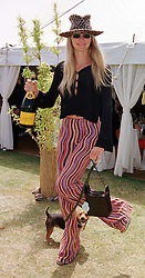 Model JODIE KIDD and her dog Inca, at a polo match in West Sussex on 18th July 1999.MUH 57