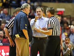 Mar 6, 2019; Morgantown, WV, USA; Iowa State Cyclones head coach Steve Prohm and West Virginia Mountaineers head coach Bob Huggins talks to an official after a double technical foul was issued during the second half at WVU Coliseum. Mandatory Credit: Ben Queen-USA TODAY Sports