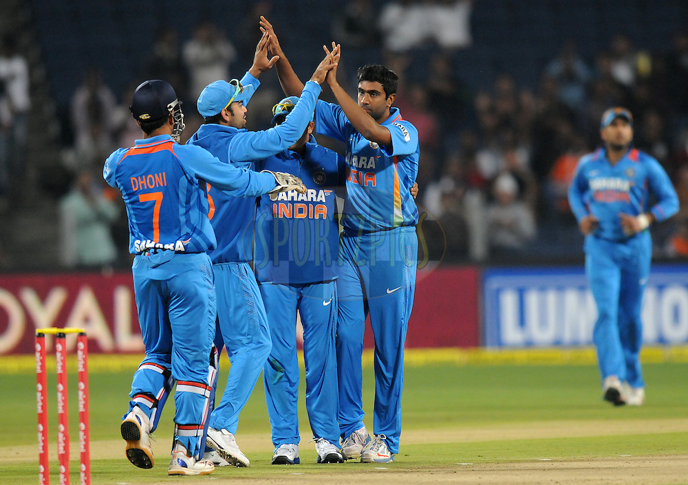 Ravichandran Ashwin of India celebrates the wicket of Michael Lumb of England during the first Airtel T20 Match between India and England held at Subrata Roy Sahara stadium in Pune on the  20th December 2012..Photo by  Pal Pillai/BCCI/SPORTZPICS .