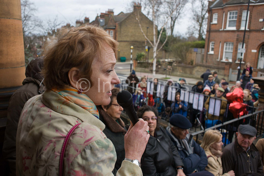 English writer Stella Duffy speaks passionately to a crowd outside Carnegie Library in Herne Hill. Faced with the closure of its beloved local library, the people of Lambeth, south London hold a demonstration outside the Edwardian-era building. Lambeth council plan to close the facility used by the community as part of austerity cuts, saying they will convert the building into a gym and privately-owned gentrified businesses - rather than a much-loved reading and learning resource. £12,600 was donated by the American philanthropist Andrew Carnegie to help build the library which opened in 1906. It is a fine example of Edwardian civic architecture, built with red Flettan bricks and terracotta, listed as Grade II in 1981.