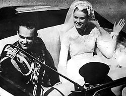 File photo dated 19/04/1956 of Grace Kelly and Prince Rainier of Monaco on their wedding day. A bridal expert has suggested that Princess Eugenie should opt for an elegant and simple wedding dress to create a memorable royal look, rather than going for over-the-top drama.