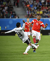 SAINT PETERSBURG, June 19, 2018  Alexandr Samedov (R) of Russia vies with Mohamed Abdelshafy of Egypt during a Group A match between Russia and Egypt at the 2018 FIFA World Cup in Saint Petersburg, Russia, June 19, 2018. Russia won 3-1. (Credit Image: © Chen Yichen/Xinhua via ZUMA Wire)